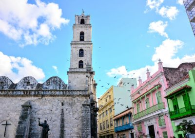 Cuban street, with mission-style church and pastel buildings