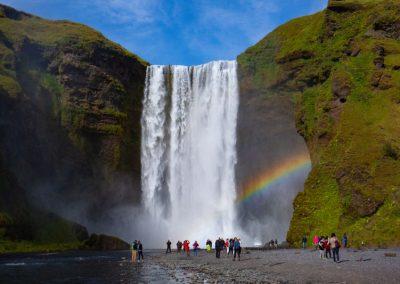 A rainbow across a waterfall