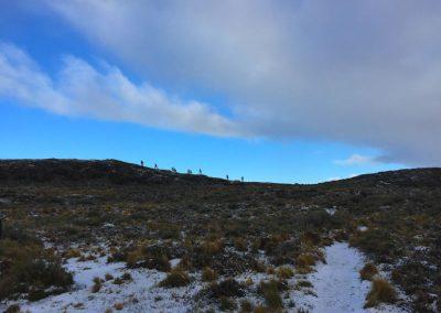 Hikers along a high ridge